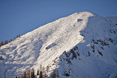 Austrian Alps peak with winter snow and ski tracks. Beautiful winter landscape,  Tauern Austrian Alps peak covered by snow in winter with ski tracks in back Royalty Free Stock Images