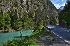 Austrian Alps-River Inn. Swiss Alps-outlook on the River In and road,in the background the peaks of the Alps Stock Photos