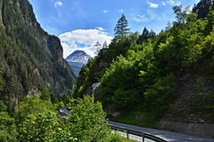 Austrian Alps-road along the river Inn to Pfunds. Austrian Alps-outlook on the road to Martina,in the background the peaks of the Alps Stock Images