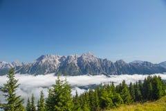 Austrian alps salzburg leogang. Blue sky morning fog beautiful scenery austrian alps in summer Royalty Free Stock Photography