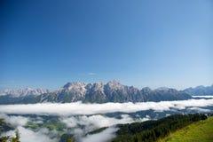 Austrian alps salzburg leogang. Blue sky morning fog beautiful scenery austrian alps in summer Royalty Free Stock Photos