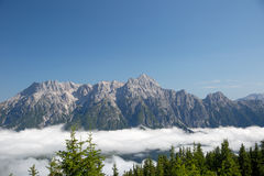 Austrian alps salzburg leogang. Blue sky morning fog beautiful scenery austrian alps in summer Stock Photos
