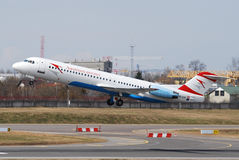Austrian arrows. Fokker 100 taking of at Vilnius intl airport Royalty Free Stock Images