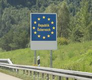 Austrian border and the road sign of the frontier. With the stars of the European community Royalty Free Stock Photography