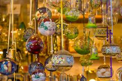 Austrian Christmas baubles in a shop window. An Austrian shop window with a lot of Christmas balls. They are glass baubles, colored and finely decorated with Stock Photo