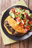 Austrian cutlet with mushrooms, scrambled eggs and vegetable sal Royalty Free Stock Image