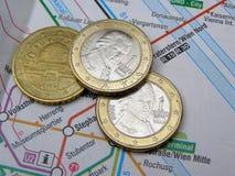 Austrian euro coins. With Mozart portrait over Vienna underground map Royalty Free Stock Photos