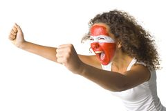 Austrian fan. Young screaming Austrian fan with painted flag on face. White background, side view Royalty Free Stock Photography