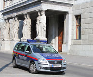The Austrian Federal Police car next to Austrian Parliament building in Vienna Royalty Free Stock Photos