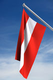 Austrian flag. Flag of Austria suspended from pole against blue sky; with clipping path stock illustration