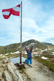 Austrian Flag above Alps mountain Stock Images