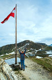 Austrian Flag above Alps mountain Royalty Free Stock Photography