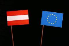 Austrian flag with European Union EU flag isolated on black. Background Royalty Free Stock Photography
