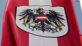 Austrian flag with national emblem, symbol waving slowly in wind. Stock footage stock video footage