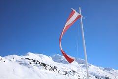 Austrian Flag near Hut at Ski Resort in Arlberg Mountains. Austria Royalty Free Stock Image