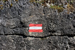 Austrian flag painting on rock wall. The red white red flag of Austria painted on a rock wall in the Allgäu Alps - for your guidance by mountain hiking Stock Images