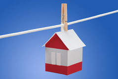 Austrian flag on paper house. Concept - Austrian flag painted on a paper house hanging on a rope Stock Photo