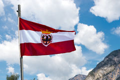 Austrian Flag with Pole on Blue Sky Royalty Free Stock Image