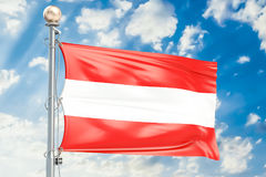 Austrian flag waving in blue cloudy sky, 3D rendering Royalty Free Stock Photos