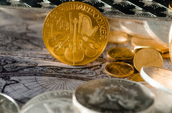 Austrian Gold Coin Philharmonic with Silver Bars & Coins.  royalty free stock photography