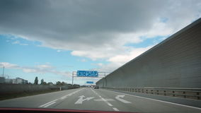 Austrian highway sign. Driving on Austrian highway with directional instruction highway sign with arrows to Praha, Vienna, Graz, Linz, St Polten Mannsworth stock video