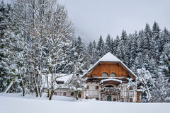 Austrian house in the snow Stock Images