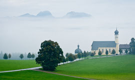 Austrian landscape with church in bad weather Royalty Free Stock Photos
