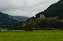 Austrian landscape. With a small church and green fields Stock Photos