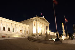 Austrian Parliament building in Vienna at night Stock Photography