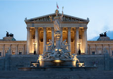Austrian Parliament in Vienna at night Stock Photo