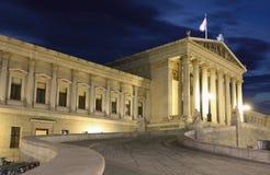 Austrian Parliament in Vienna at night Stock Photos