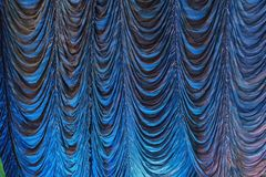 Austrian pleated main front stage curtain. With blue highlight Stock Photography