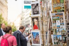 Austrian postcards. Focus on Mozart picture card on busy tourist attraction street Royalty Free Stock Photo