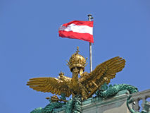 Austrian regalia. Eagle and flag on top of the vienna hofburg royalty free stock photos