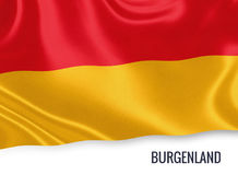 Austrian state Burgenland flag. Austrian state Burgenland flag waving on an isolated white background. State name is included below the flag. 3D rendering Royalty Free Stock Photo
