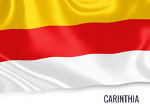 Austrian state Carinthia flag. Austrian state Carinthia flag waving on an isolated white background. State name is included below the flag. 3D rendering Royalty Free Stock Photography