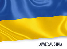 Austrian state Lower Austria flag. Austrian state Lower Austria flag waving on an isolated white background. State name is included below the flag. 3D rendering Stock Photo