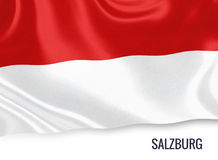 Austrian state Salzburg flag. Austrian state Salzburg flag waving on an isolated white background. State name is included below the flag. 3D rendering Stock Photography