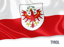 Austrian state Tyrol flag. Austrian state Tyrol flag waving on an isolated white background. State name is included below the flag. 3D rendering Royalty Free Stock Image