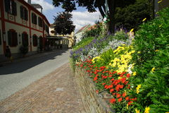 Austrian street with flowers Royalty Free Stock Photos