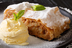 Austrian traditional apple strudel with ice cream and mint close. Up on a plate. Horizontal Royalty Free Stock Image