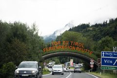 Austrian and travelers people driving car and riding motorbike on the road royalty free stock photo