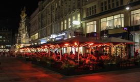 Austrian, Vienna, October 21 2018: Column of Pest and Graben photographed in the evening with restaurant outer spaces in the royalty free stock images