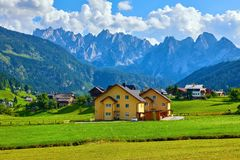 Free Austrian Village Among Meadows Fields And Alpine Royalty Free Stock Photography - 132497047