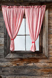 Austrian window. A nice window in Austria with red and white curtain Royalty Free Stock Image