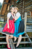 Austrian Woman standing by a wooden Hut. Young austrian Woman standing by a wooden Hut Stock Photo