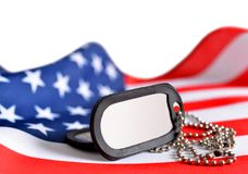Ausweise der amerikanischen Flagge und der Soldaten Lizenzfreies Stockfoto