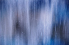 Auszugshintergrund des blauen Wassers Lizenzfreie Stockfotografie