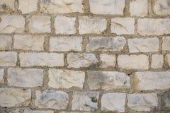 Autentiska roman stentegelstenar för textur Royaltyfria Foton