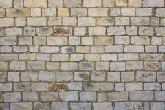 Autentiska roman stentegelstenar för textur arkivfoton